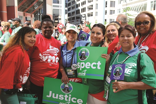 UDW President Editha Adams (third from left) and caregivers rally for workers' rights in Chicago, IL.