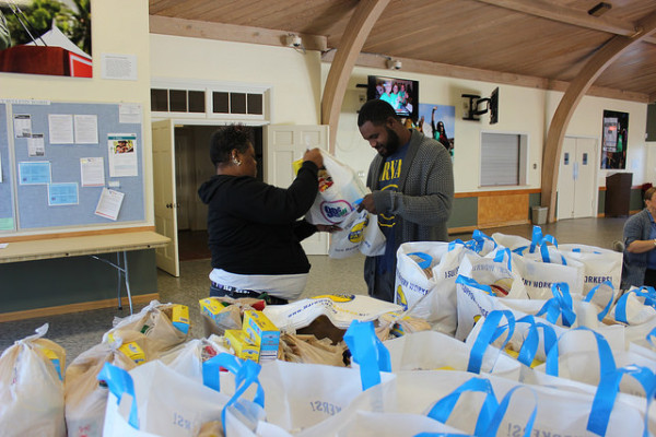 Volunteers preparing bags for a monthly Food for Families distribution
